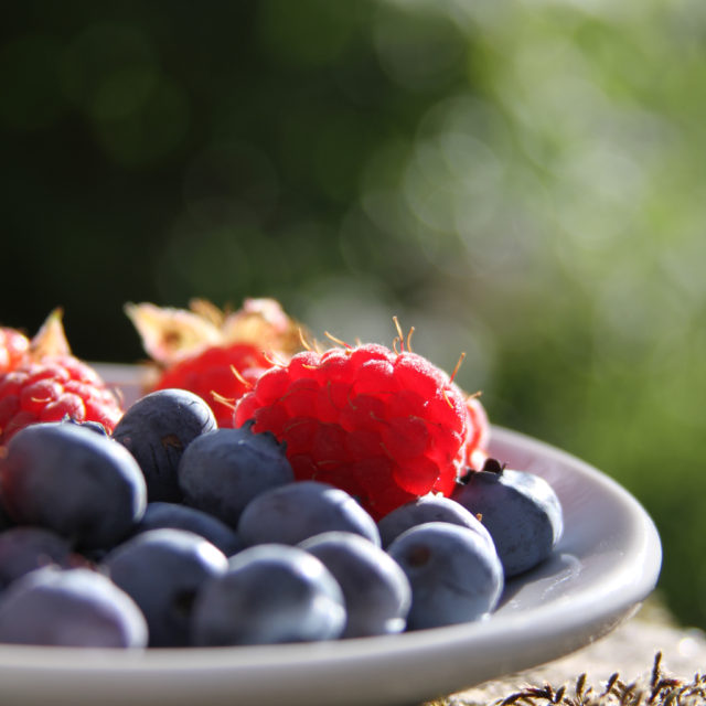 foods for boosting mood berries in bowl with sunlight behind