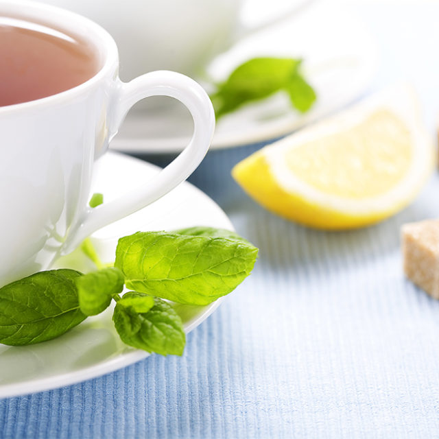 Cup of tea fresh mint and lemon wedge how I can help you