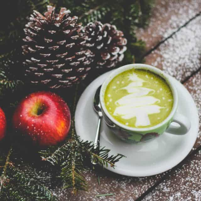 Image for PCOS survival guide. Christmas latte with apples and pine cones
